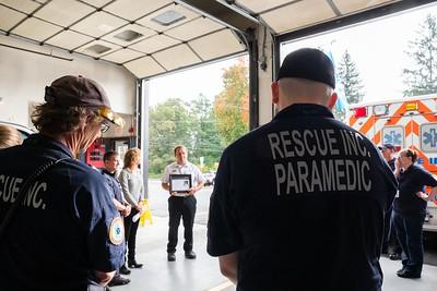 Paramedics at Rescue Inc., look on as Drew Hazleton receives the Mission Lifeline Silver Plus Achievement Award from Sarah Duzinski of the American Heart Association.  (photo:  Kelly Fletcher)