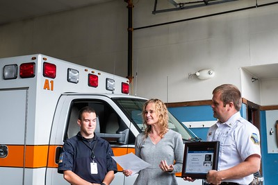 Sarah Duzinski, Director of Quality & Systems Improvement for the American Heart Association in Austin, TX, presents the Silver Plus Mission Lifeline Achievement Award to Rescue Inc. on Thursday, September 26th.  Pictured with Sarah are Paramedic, Jeff Frizzell (left) and Chief, Drew Hazelton (right). (photo:  Kelly Fletcher)