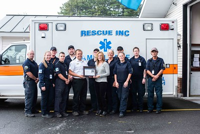 Paramedics at Rescue Inc. pose with Sarah Duzinski of the American Heart Association after being presented with the Mission Lifeline Silver Plus Achievement Award.  (photo:  Kelly Fletcher)