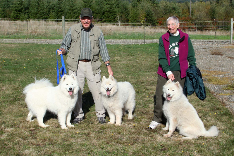 Loki (left) with George, Louise, and the girls.