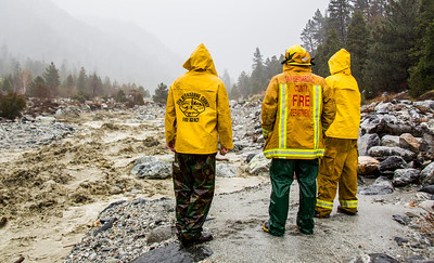 Forest Falls fire fighters checking mill creek during winter storm flood(By Brandon Barsugli)