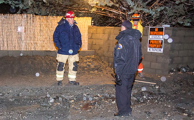 Glen Helen Crew helping sand bag a local home to help prevent future flooding(By Brandon Barsugli)