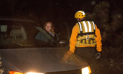 Swift water team talking with local residents in the area about safety during the storm (By Brandon Barsugli)