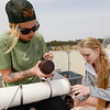 Master's student Paige Plier helps Freshman Kristina Samborski in the OUR Explorers Program collect water samples in Santa Rosa Sound Wednesday March 16, 2016 in Pensacola, Florida. (Michael Spooneybarger/ CREO)