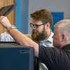 University of West Florida student Chris Borthwick and Daniel Krug, of the Office of Career and Professional Education, work in UWF's Sea3D Additive Manufacturing Lab in the Museum of Commerce January 26, 2018. The space is a unique community-based lab where University students and clients create and print 3D products. The lab is the first launch of UWF's Innovation Network initiative.