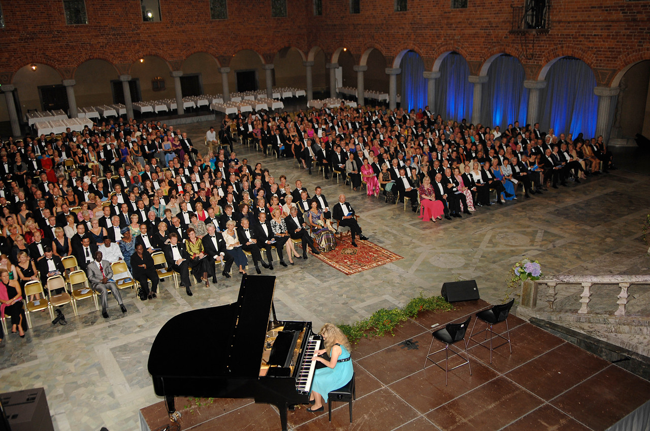 A view of the award ceremony performances, in the Blue Room.  The Carpenters are seated in the front row, far right. Photo by the Stockholm International Water Institute under the Creative Commons license.