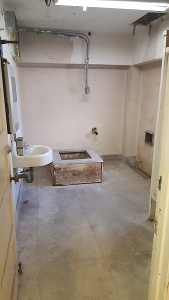 November continues with the removal of incorrect modifications and investigative work. This room in the basement was turned into a bathroom and furnace room, and a door and a window were added. In this picture, we have already removed the furnace, but the base remains.