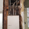 To start on the electrical system upgrade, we have to map out where all of the electrical wires are running currently.  We removed the plaster and lath from above the sub-panel, and found a whole bunch of conduits.