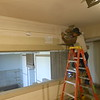 We start work in the Dining Room.  The carpenter is starting by removing the plywood that is covering the clerestory window openings.  A second rood was added long ago, covering the original clerestory windows.