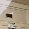An electrical outlet was installed where a clerestory window used to be.