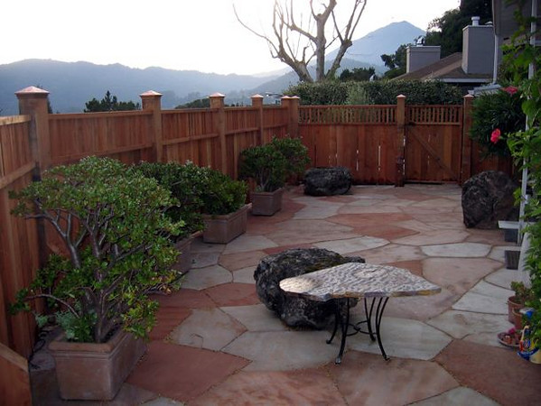 Where recently it was open soil and old junipers, now it's a beautiful, private outdoor room with a view of Mount Tamalpais.