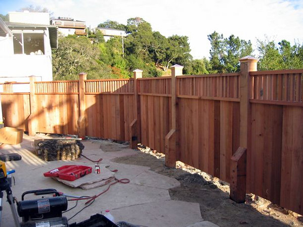 The new fence and flagstone patio under construction.