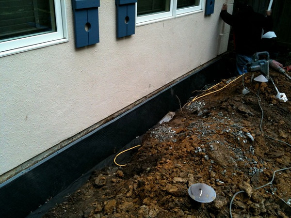 Protection to the foundation and a drainage system that feeds into a sump, from which the water is pumped off the property.