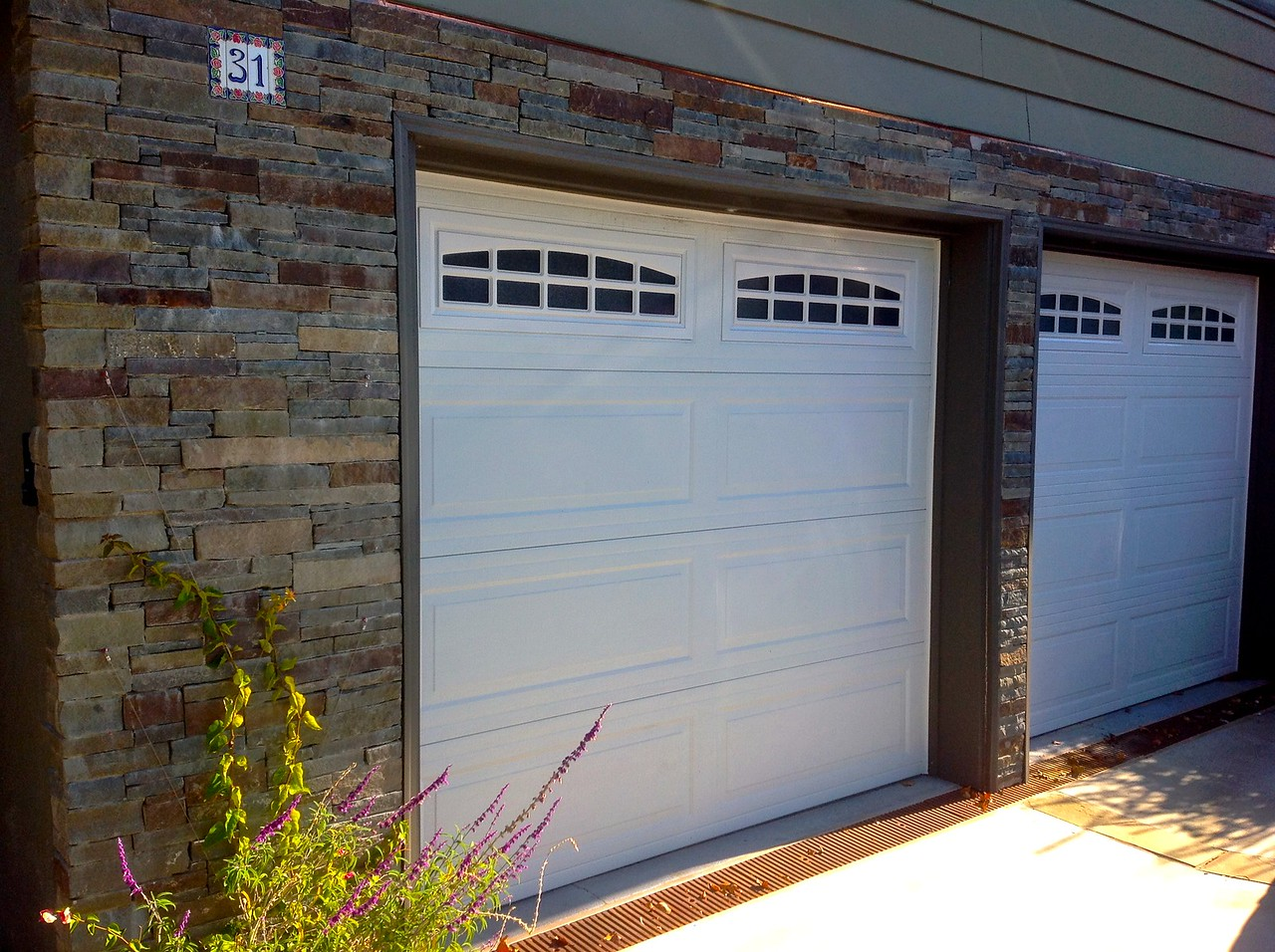 The completed ledge stones around the garage doors.