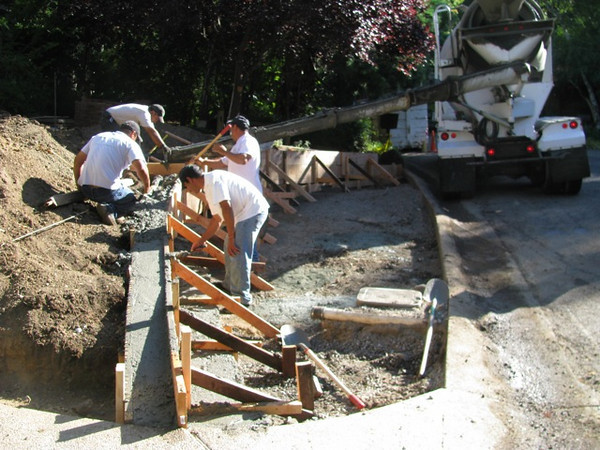 The concrete is delivered and poured into the forms.