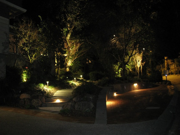 Low-voltage, LED lighting enhances the garden and entry at night, allowing visitors to safely enter and leave the residence and to appreciate the garden.