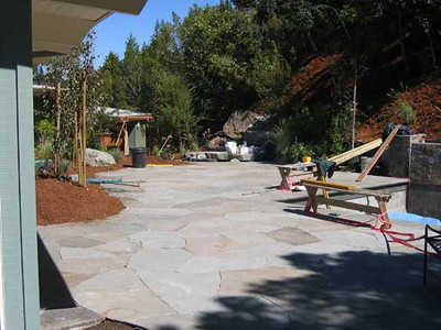 Mulch and plant materials carry across the yard, ultimately integrating this garden with the larger mountainside.