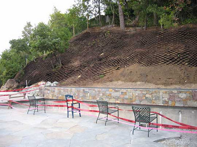 A special approach to retaining good soil for planting on a steep hillside.