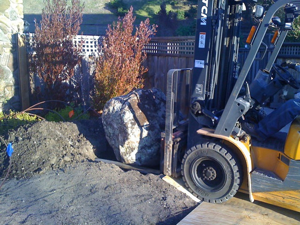 Large decorative boulders were imported to enhance the beauty of the landscaping.