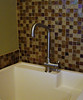 laundry room sink area with tile