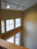 view from office loft, raised ceiling over living room area