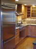 Cooktop and refrigerator side of kitchen