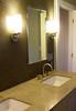 master bath vanity with lighting and glass tile
