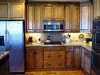 kitchen cooktop and refrigerator