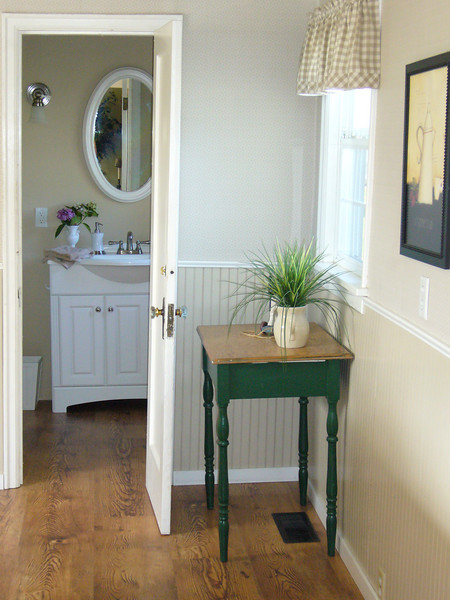 view to remodeled powder room, new flooring