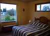 master bedroom - large windows with views to mount baker