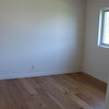 After - Upstairs Bedroom Painted and new floors installed