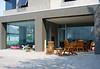 Outdoor patio, views through glass to living room, exterior fireplace