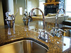 Details of the bar area, granite countertops, mirror wall tiles reflect grand living area