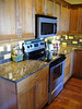Quality Hertco cabinets,granite countertops and glass tiles