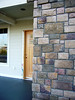 stonework, colored concrete and front door