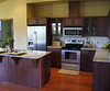 Kitchen featuring maple cabinets, wood flooring, granite countertops and Whirlpool appliances with a satina finish.