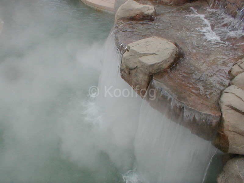 Fog Underneath Rock Features in Waterfall
