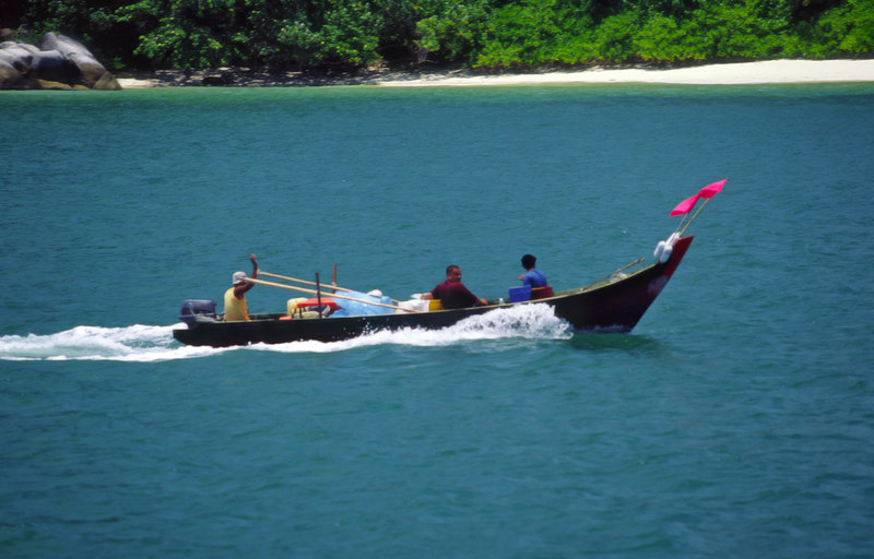 A long boat is a common means of local transportation off the coast of Perak, Selat Melaka (Straits of Malacca), Malaysia, Asia.