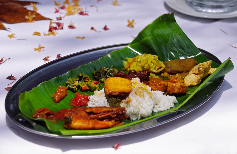 Appetizers are served against the lovely green of a banana leaf at Pangkor Laut Resort, an exclusive private island retreat in Malaysia, Asia.