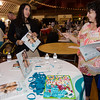 Lorrayne Dos Santos, of Pathways for Change, speaks with Marlyn Costa during the community resource fair at the Fitchburg Senior Center on Thursday evening. SENTINEL & ENTERPRISE / Ashley Green
