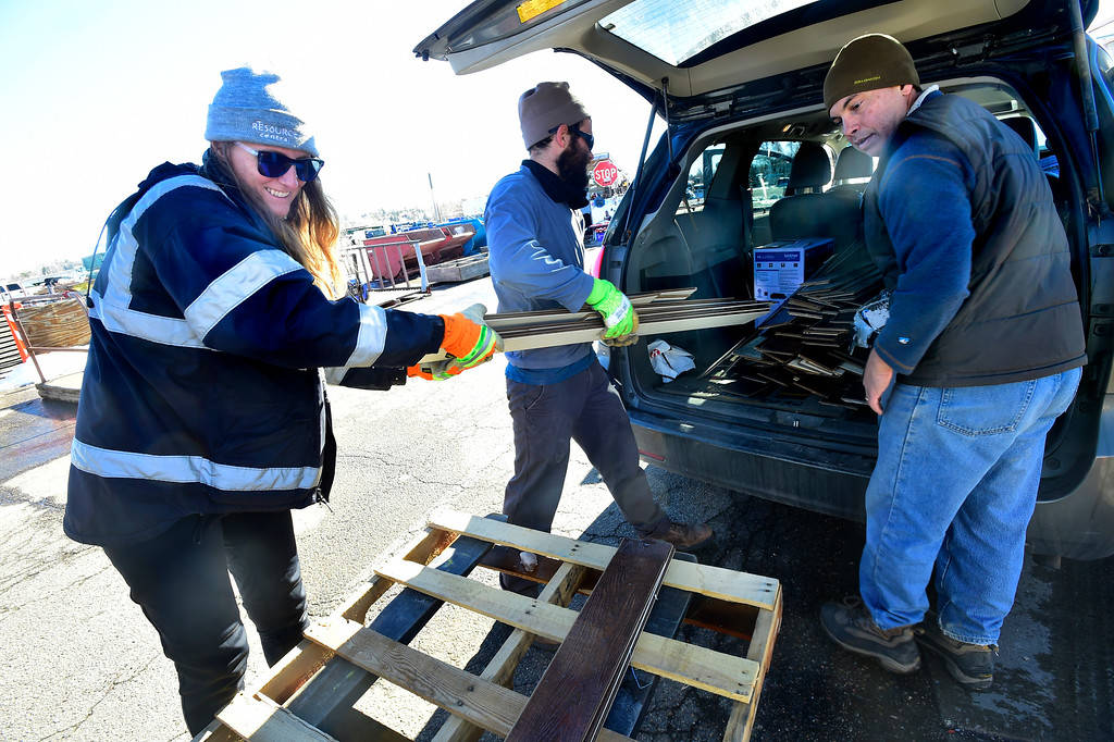 . BOULDER, CO - NOVEMBER 13, 2018  Lauren Brueggeman, left and Ethan Jones help Eric Nudelman, right, load flooring material into his car at the Resource Materials Reuse & Tool Library facility on Arapahoe Road on Tuesday morning. Nudelman has done extensive renovations on his home using materials he has found at Resource. For more photos go to dailycamera.com.  (Photo by Paul Aiken/Staff Photographer)