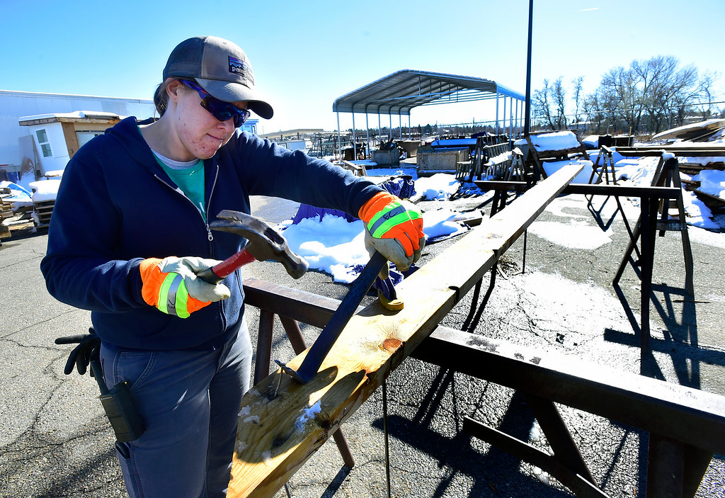 . BOULDER, CO - NOVEMBER 13, 2018  Emily Chiles works to clear nails from donated lumber at the Resource Materials Reuse & Tool Library facility on Arapahoe Road on Tuesday morning. For more photos go to dailycamera.com. (Photo by Paul Aiken/Staff Photographer)