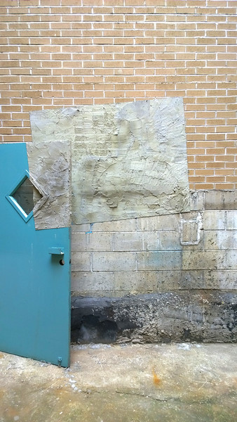 Doorway By Bricklayers & Artist. Concrete on door with stone work, 12ft. x 8ft. 2016.
