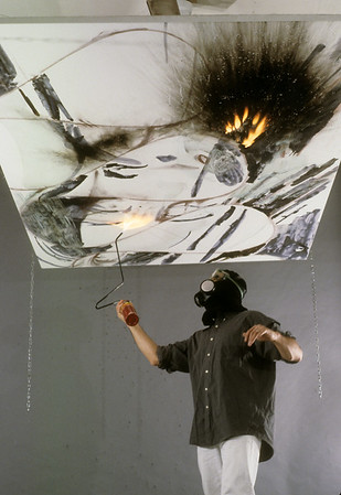 Burning/scorching surface of canvas with a torch, slide 1. Afterwards, the burned and smoky plane is sealed with clear emulsion.