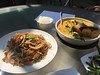 Soy chow mein (left) and shrimp and scallop curry