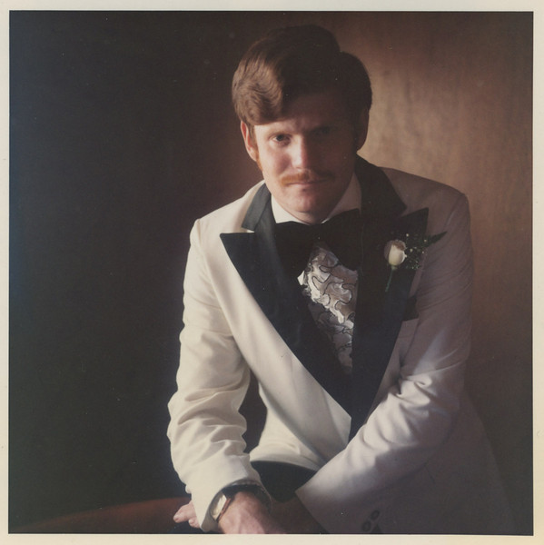 Groom before - this 1970s color photograph mainly suffered from color fading.