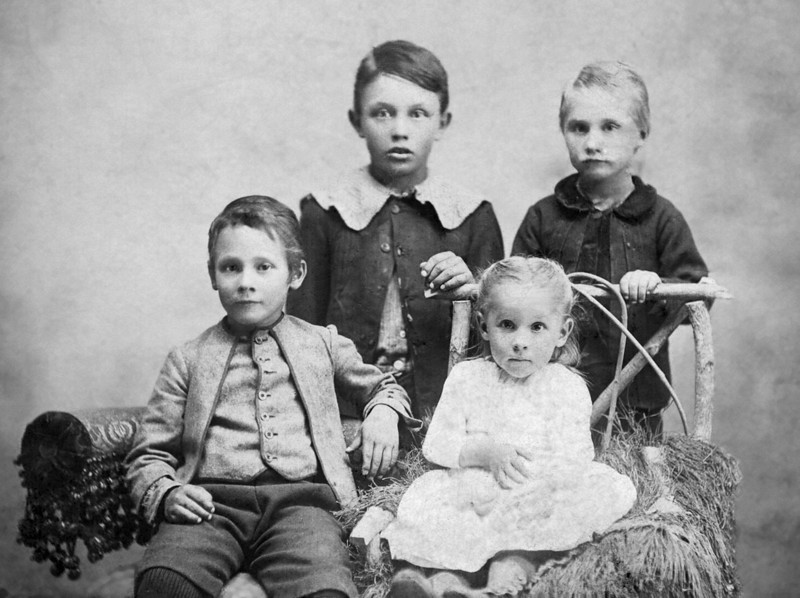 Turner kids, Kansas 1895, after restoration.<br /> Restoration included improving contrast, repairing the tear, increasing detail to the girl's dress, removing the dark fingerprint on the boy in upper right, cleaning up spots, and cropping.