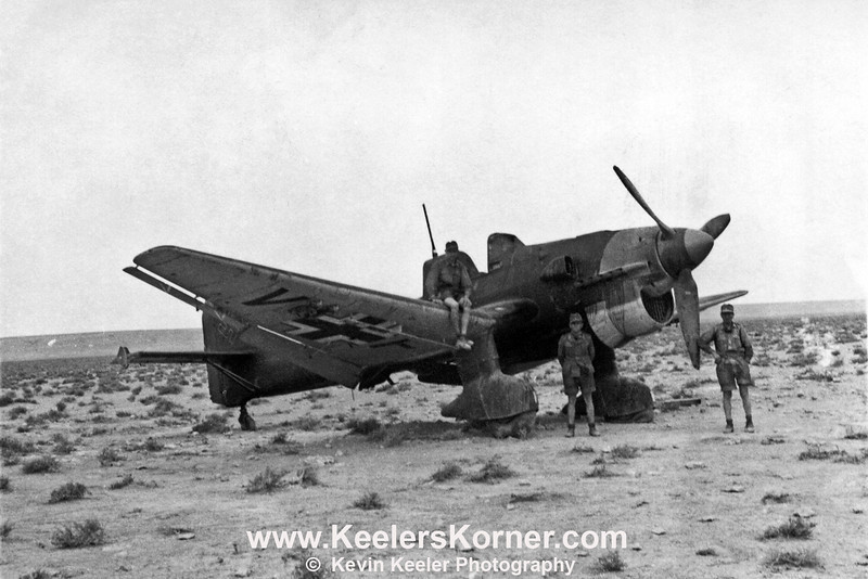 "Junkers Ju-87 ""Stuka"" Dive Bomber probably taken somewhere in North Africa. Note the flat left tire.<br /> <br /> This is a restoration of an original photo. Details regarding location date and personnel are unknown.<br /> <br /> Photo displayed and reproduced with the permission of the owner."