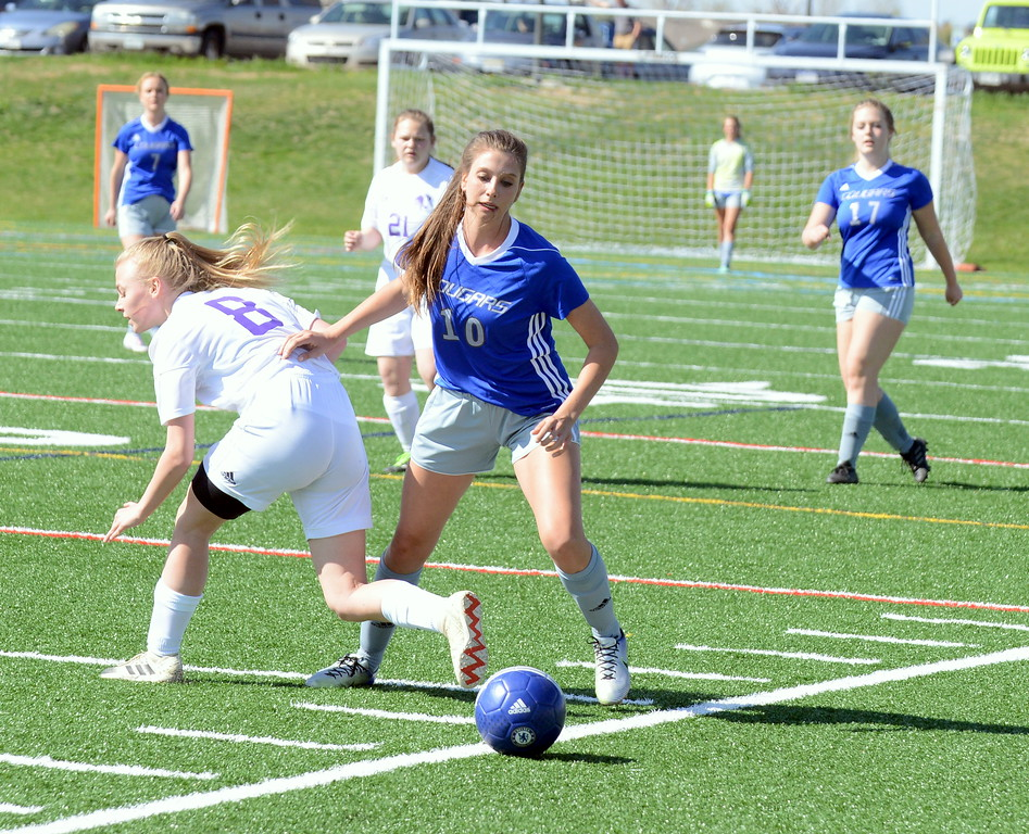 . Resurrection Christian\'s Molli Peacock battles with Estes Park\'s Camdyn Arnold for possession during Thursday\'s Patriot League game at Loveland Sports Park. (Mike Brohard/Loveland Reporter-Herald)