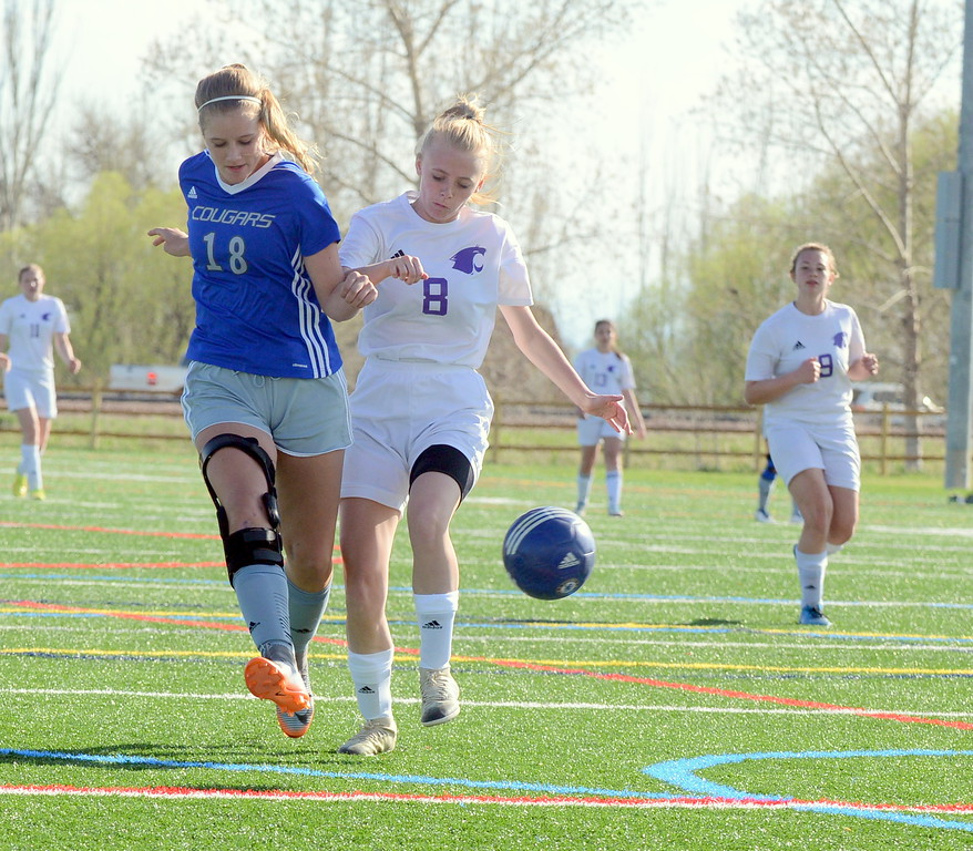 . Estes Park\'s Camdyn Arnold is too late to stop Resurrection Christian\'s Ella Peacock from firing off a shot for a goal during Thursday\'s Patriot League game at Loveland Sports Park. (Mike Brohard/Loveland Reporter-Herald)